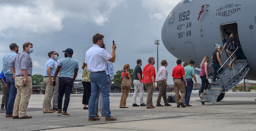 Local community members, line up to board a C-17 Globemaster III static display as part of a Leadership Charleston Tour at Joint Base Charleston, S.C., Aug 20, 2020. Members of Charleston organizations such as the Charleston Metro Chamber, encourage strengthening relationships between the community and military to support service members and their families, expanding the federal footprint in the region.
