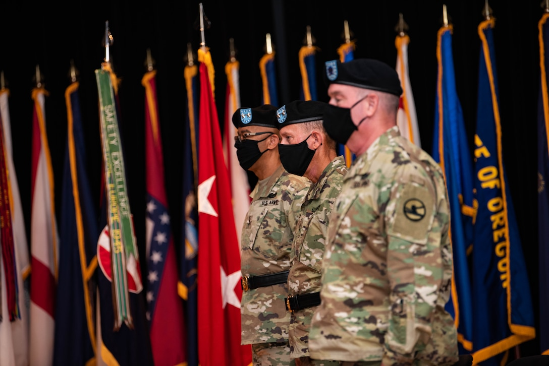 From left, Maj. Gen. A.C. Roper, the deputy commanding general of the U.S. Army Reserve; Maj. Gen. Steven W. Ainsworth, the outgoing commander of the 84th Training Command; and Ainsworth's senior enlisted leader Command Sgt. Maj. Lawrence G. May, participate in Ainsworth's relinquishment-of-command and retirement ceremonies at Fort Knox, Ky., Aug. 22, 2020.
