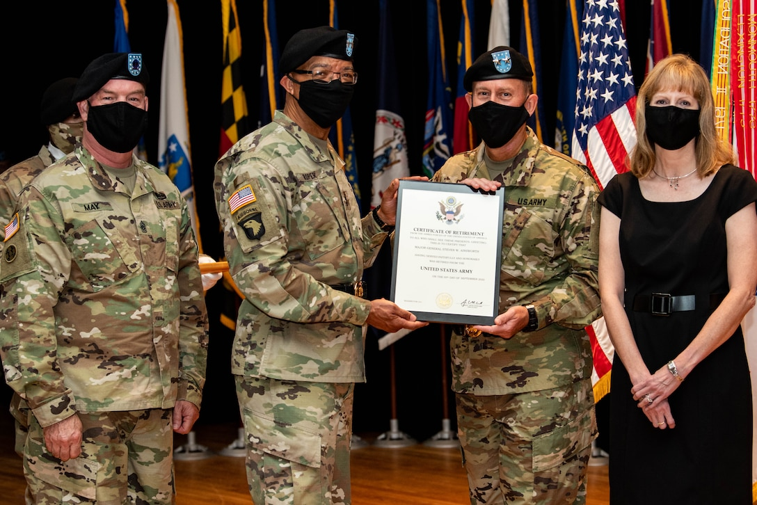 From left, Command Sgt. Maj. Lawrence G. May, the 84th Training Command's senior enlisted leader; Maj. Gen. A.C. Roper, the deputy commanding general of the U.S. Army Reserve; Maj. Gen. Steven W. Ainsworth, the outgoing commander of the 84th, and Susanne, his wife, participate in Ainsworth's relinquishment-of-command and retirement ceremonies at Fort Knox, Ky., Aug. 22, 2020.
