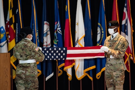 Soldiers fold the U.S. flag during the relinquishment-of-command and retirement ceremonies in honor of Maj. Gen. Steven W. Ainsworth, the outgoing commander of the 84th Training Command, Aug. 22, 2020, at Fort Knox, Ky.