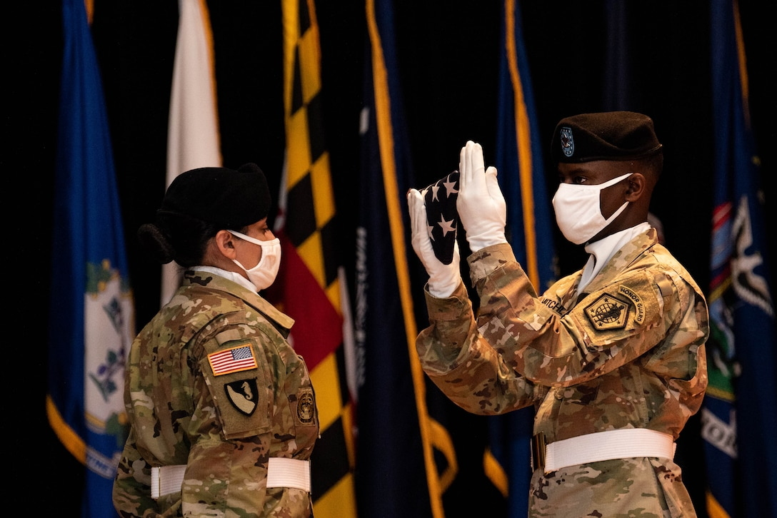 A Soldier inspects the U.S. flag during the relinquishment-of-command and retirement ceremonies in honor of Maj. Gen. Steven W. Ainsworth, the outgoing commander of the 84th Training Command, Aug. 22, 2020, at Fort Knox, Ky.