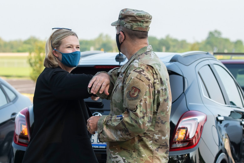 Caption: Col. Patrick Miller, 88th Air Base Wing commander, greets City of Dayton Mayor Nan Whaley upon her arrival at the National Museum of the United States Air Force, Wright-Patterson Air Force Base, Aug. 25. Whaley visited the museum to record her keynote address to be aired during the annual Women's Equality Day event. (U.S. Air Force photo by Wesley Farnsworth)
