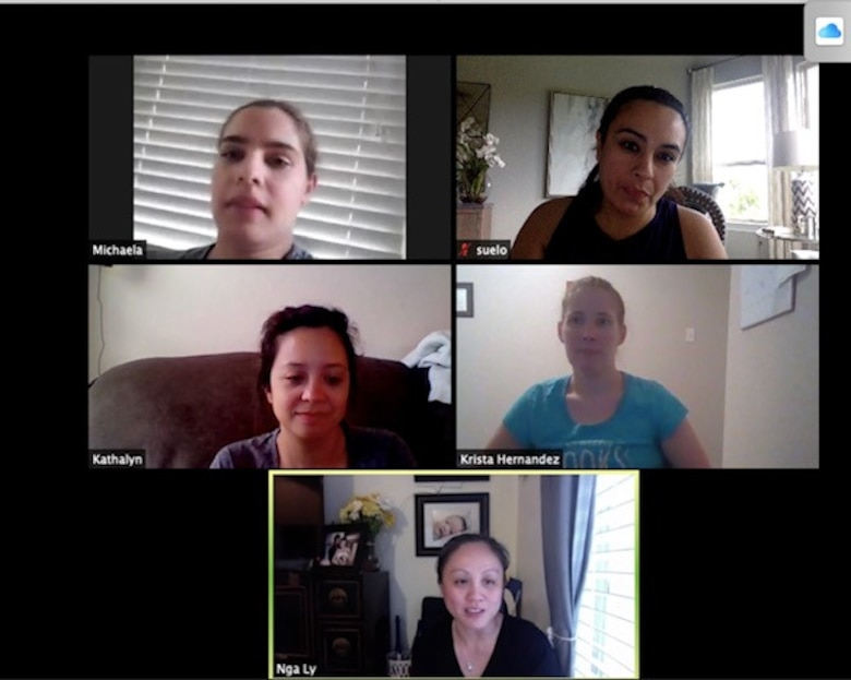 Five women participating in a virtual, computer meeting.