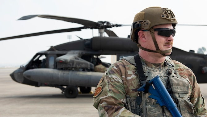 Airman guarding helicopter