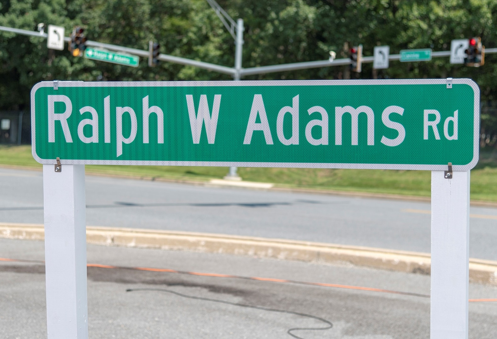 Ralph W Adams Road sign