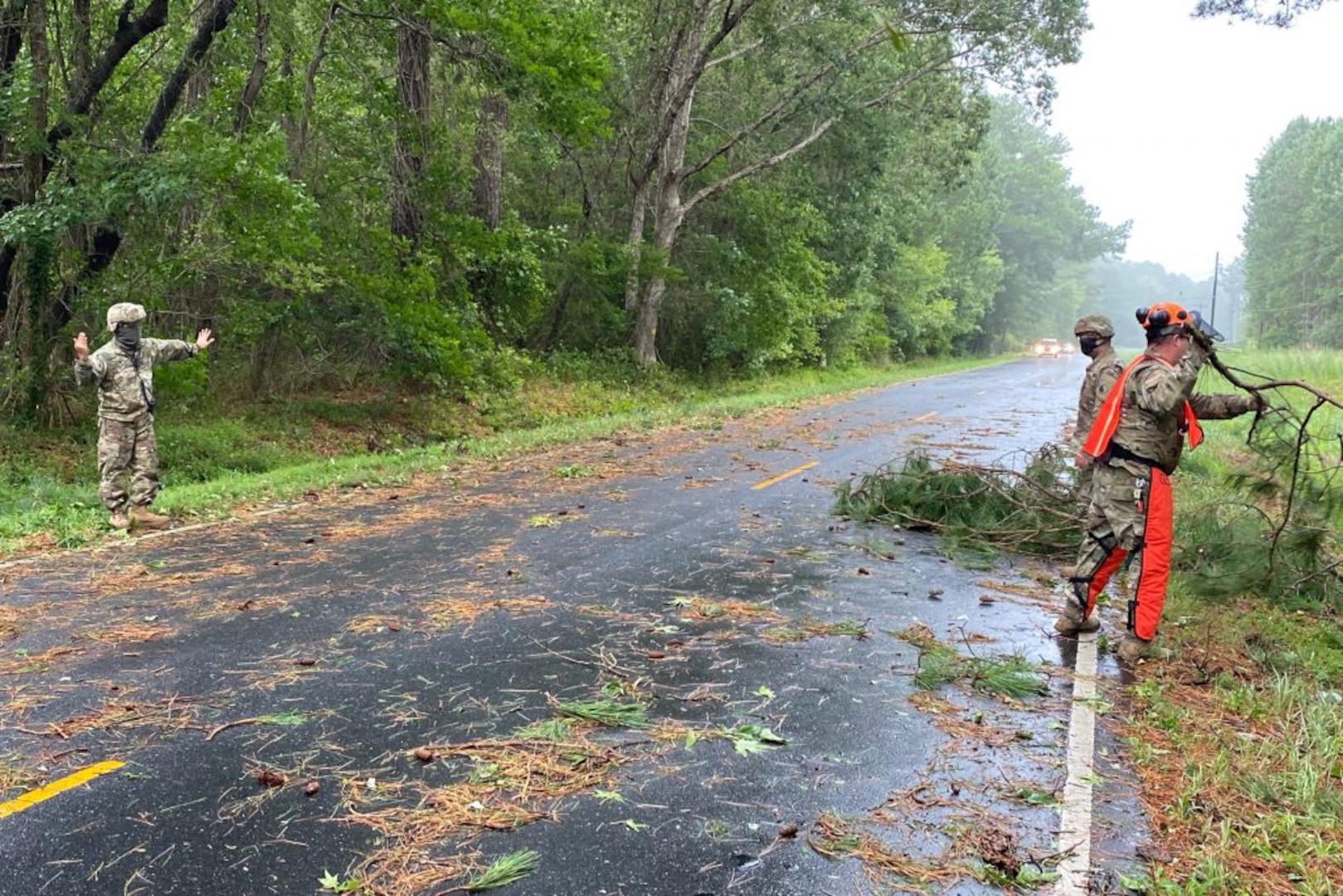 VNG Soldiers clear debris in Onancock following storm