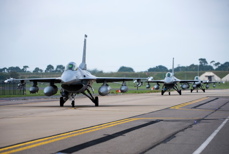 U.S. Air Force F-16 Fighting Falcons, assigned to the 510th Fighter Squadron, Aviano Air Base, Italy, arrive at Royal Air Force Lakenheath, England, Aug. 28, 2020. Aircraft and Airmen from the 510th FS are participating in a flying training deployment event to enhance interoperability, maintain joint readiness and strengthen relationships with regional allies and partners. (U.S. Air Force photo by Airman 1st Class Jessi Monte)