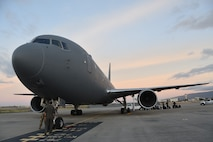 A KC-46A Pegasus assigned to the 22nd Air Refueling Wing at McConnell Air Force Base, Kansas, prepares for takeoff Aug. 21, 2020, at Hickam Air Force Base, Hawaii.  The KC-46 was part of the first 931st Air Refueling Wing-lead cargo mission which helped offload more than 11,000 pounds of pallets to four locations worldwide in six days.