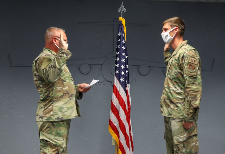 Father re-enlist son into the Air Force Reserve