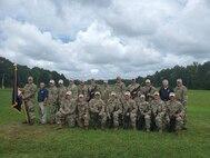 The Army Reserve Service Rifle Team at the 59th Interservice Rifle Championships at the Marine Corps Base in Quantico, Virginia. Back row (L to R): SPC Mason Petersen, Mr. Jon Casillas, COL Christopher Baer, CW3 Joseph Hayes, SFC Richard Hartley, SSG Sean Morris, MAJ David Yerkes, MSG Joseph Braswell, SFC John Arcularius, SFC Adam Stauffer, SSG Matt Goad, Mr. Stephen Austin (ACAR), MSG Howard Griffith. Front row (L to R): 2LT Jack Pitman, CDT Cameron Bates, SPC Dan Lowe, SGT Drew Wood, SGT Keith Stephens, SFC Cheryl Morris, SFC John Bonjour, SFC Dan Dorosheff.