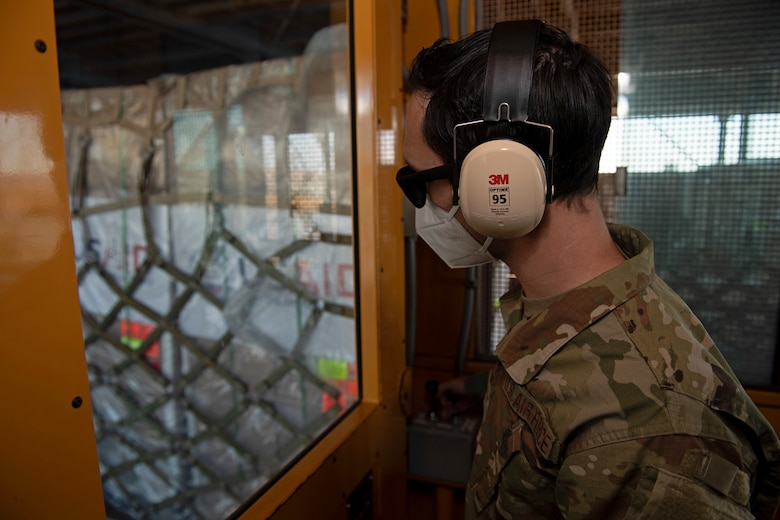 photos of aerial port airmen loading USAID of ventilators into a c-17 globemaster III.