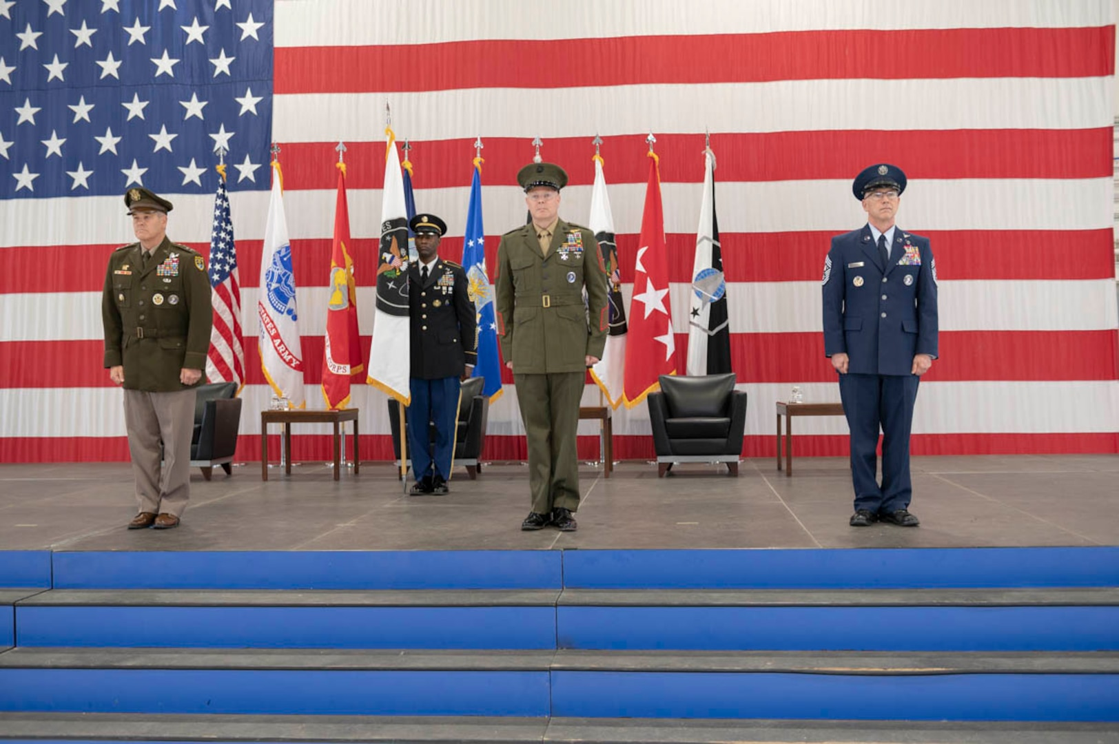 U.S. Army Gen. James Dickinson, U.S. Space Command commander; U.S. Marine Corps Master Gunnery Sgt. Scott Stalker; and U.S. Space Force Chief Master Sgt. Roger Towberman stand at attention during USSPACECOM's change of responsibility ceremony Aug. 28, 2020, at Peterson Air Force Base, Colorado. Stalker assumed responsibility as USSPACECOM's command senior enlisted leader from Towberman during the ceremony. This was USSPACECOM's first change of responsibility since the command was established Aug. 29, 2019.