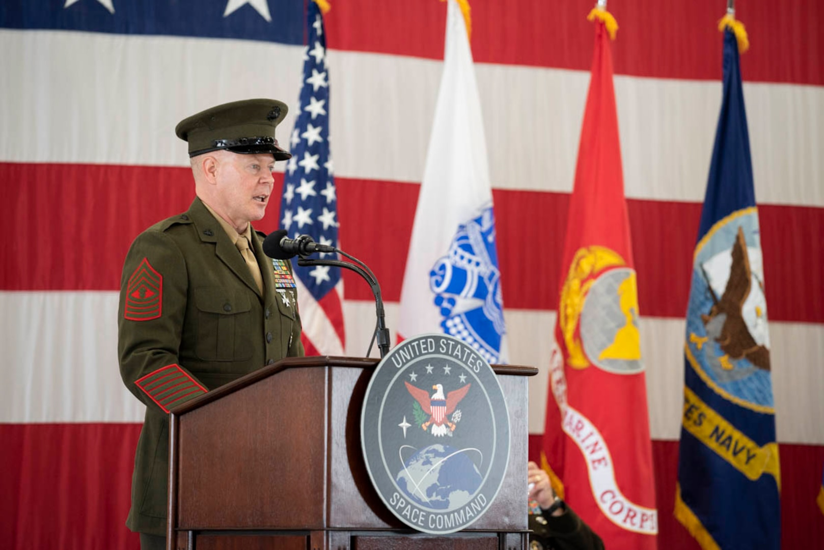 U.S. Marine Corps Master Gunnery Sgt. Scott Stalker speaks during a change of responsibility ceremony Aug. 28, 2020, at Peterson Air Force Base, Colorado. During the event, the first since USSPACECOM was established Aug. 29, 2019, U.S. Space Force Chief Master Sgt. Roger Towberman relinquished responsibility of the combatant command's highest enlisted position to Stalker, who previously served as command senior enlisted leader for U.S. Cyber Command and the National Security Agency.