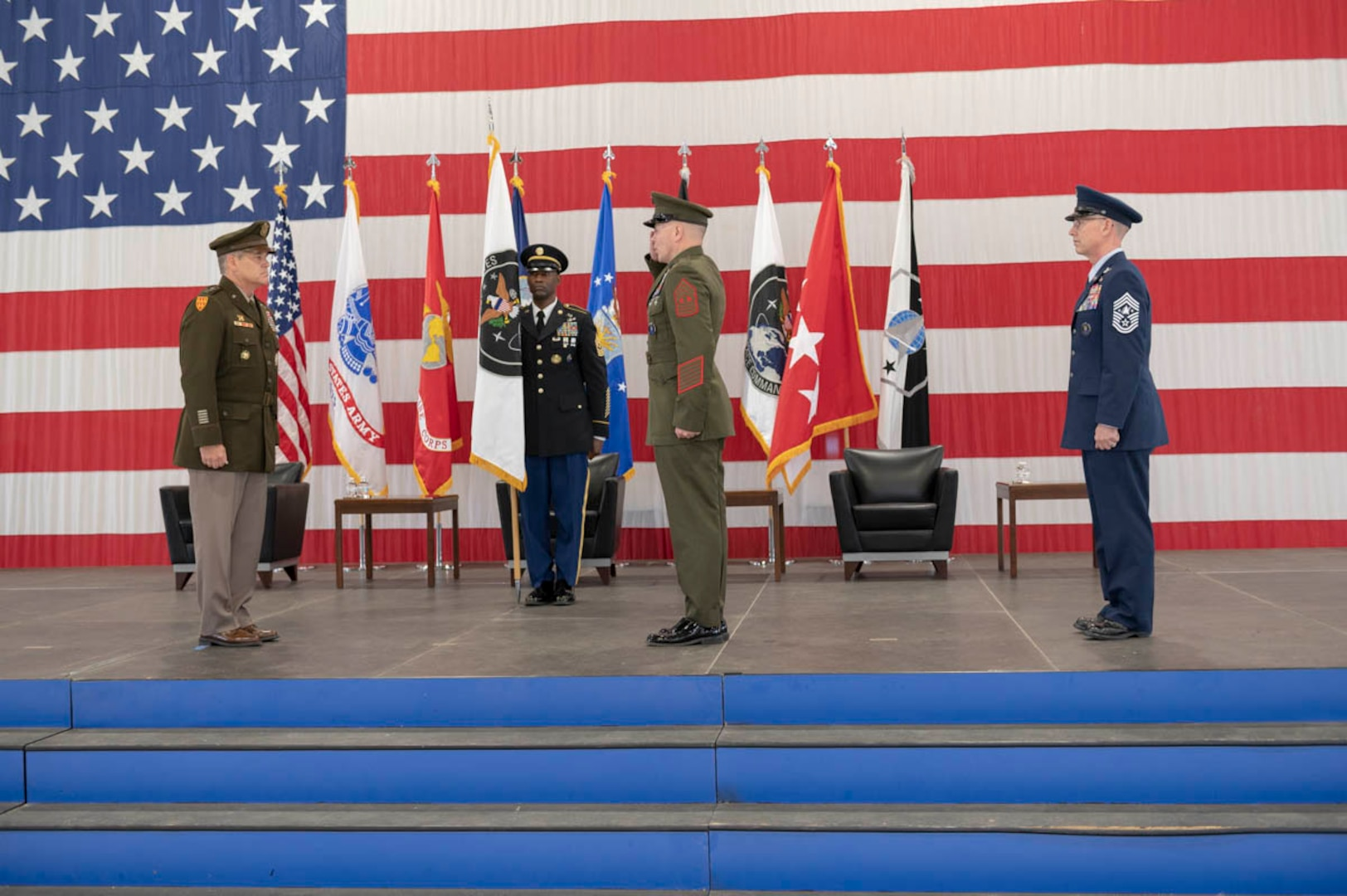 U.S. Marine Corps Master Gunnery Sgt. Scott Stalker accepts the U.S. Space Command colors from U.S. Army Gen. James Dickinson, USSPACECOM commander, Aug. 28, 2020, during a change of responsibility for the combatant command at Peterson Air Force Base, Colorado. Stalker assumed responsibility as USSPACECOM's command senior enlisted leader from U.S. Space Force Chief Master Sgt. Roger Towberman during the ceremony. Due to heightened health precautions leaders did not do a traditional passing of the colors during the ceremony. Instead, the colors entrusted to Command Sgt. Maj. Eric McCray, USSPACECOM Commandant.