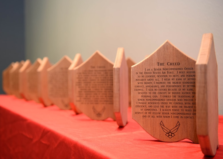 Plaques sit on a table displaying the senior noncommissioned officer creed during the SNCO Induction Ceremony at the event center on Goodfellow Air Force Base, Texas, Aug. 27, 2020. The SNCO inductees vowed to uphold the creed during the induction ceremony. (U.S. Air Force photo by Airman 1st Class Ethan Sherwood)