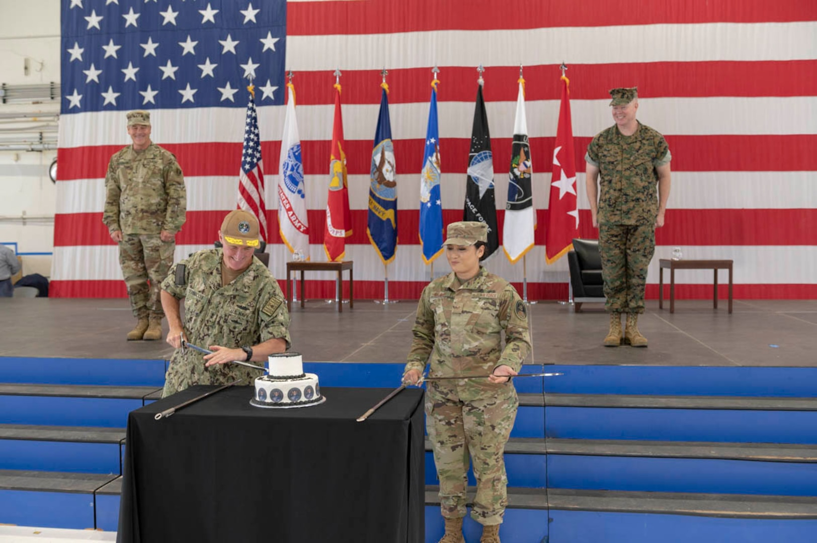 "U.S. Navy Rear Adm. Michael Bernacchi, rightt, and U.S. Air Force Staff Sgt. Kiara Kashner, right, representing U.S. Space Command's longest-serving and junior-serving members, respectively, cut a cake in honor of the combatant command's first birthday Aug. 28, 2020, at Peterson Air Force Base, Colorado. Kashner serves as executive assistant to the commandant and Bernacchi is Strategy, Plans and Policy director. USSPACECOM was officially established Aug. 29, 2019, during a ceremony in the White House Rose Garden with President Donald Trump; Dr. Mark T. Esper. Secretary of Defense; and Gen. John W. ""Jay"" Raymond, former USSPACECOM commander and current U.S. Space Force Chief of Space Operations; and Chief Master Sgt. Roger Towberman, former USSPACECOM command senior enlisted leader and current USSF CSEL."
