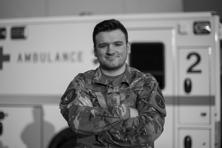U.S. Air Force Airman 1st Class William Young, 60th Medical Operations Squadron emergency medical technician, stands in front of an ambulance Aug. 26, 2020, at Travis Air Force Base, California. Young was part of a team that evacuated 20 patients from David Grant USAF Medical Center Aug. 19 as the LNU Lightning Complex Fire, the second largest wildfire in California history, burned its way toward the base. (U.S. Air Force photo by Senior Airman Cameron Otte)