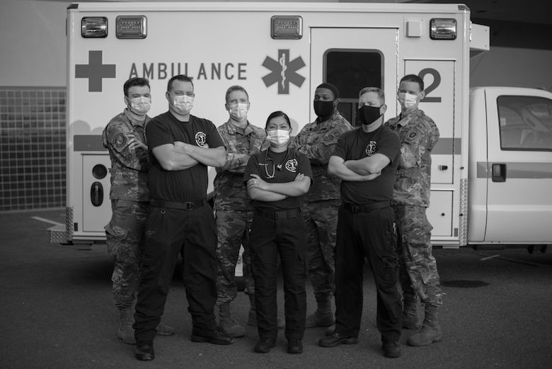 U.S. Airmen assigned to the 60th Medical Operation Squadron stand in front of an ambulance Aug. 26, 2020, at Travis Air Force Base, California. These members of the 60th MDS were part of a team that evacuated 20 patients from David Grant USAF Medical Center Aug. 19, after the 60th Air Mobility Wing commander issued an evacuation order for Travis AFB in response to a wildfire nearing the installation. (U.S. Air Force photo by Senior Airman Cameron Otte)