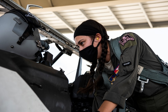 Capt. Kimberly Bray, 47th Operations Support Squadron executive officer and instructor pilot, performs pre-flight checks on a T-6A Texan II at Laughlin Air Force Base, Texas, Aug. 26, 2020. Laughlin observes Women's Equality Day by flying an all-female formation sortie with instructor and student pilots. (U.S. Air Force photo by Senior Airman Marco A. Gomez)