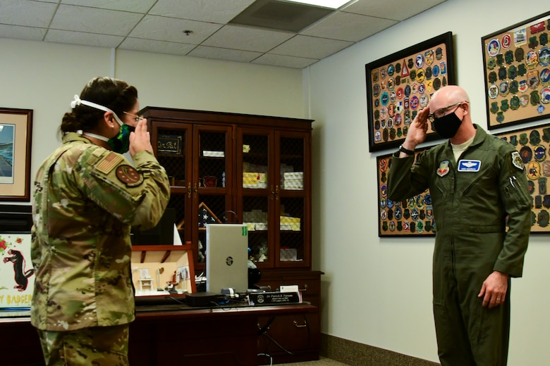 A photo of an officer saluting a general.