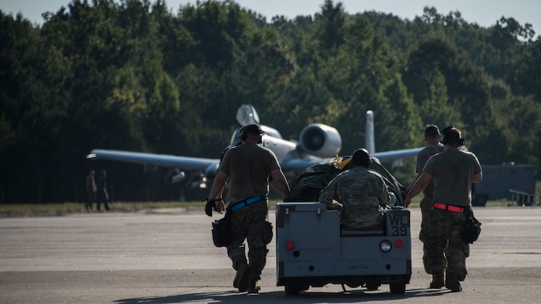A photo of Airmen moving equipment