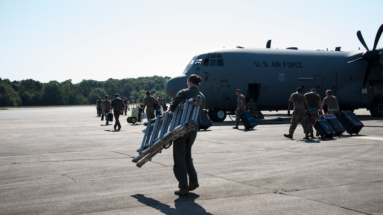 A photo of Airmen moving gear
