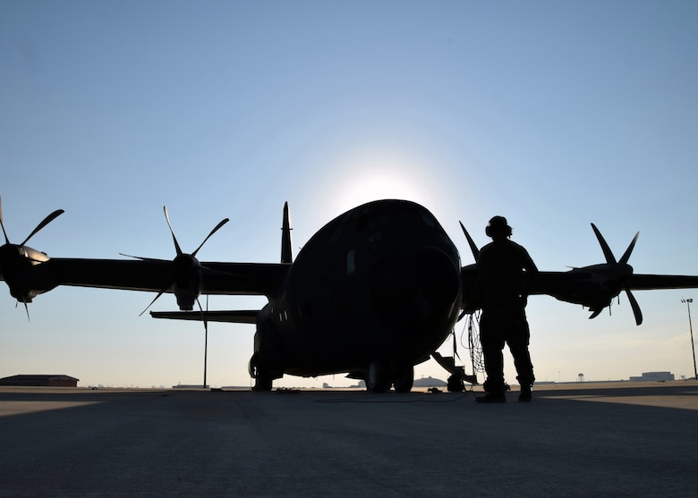 Staff Sgt. Zachary Faith, 403rd Aircraft Maintenance Squadron crew chief, performs a pre-flight check on a C-130J Hercules cargo aircraft Aug. 25 at Joint Base San Antonio-Lackland. Eight C-130Js evacuated from Keesler Air Force Base, Mississippi, to avoid damage from Hurricane Marco and Tropical Storm Laura.