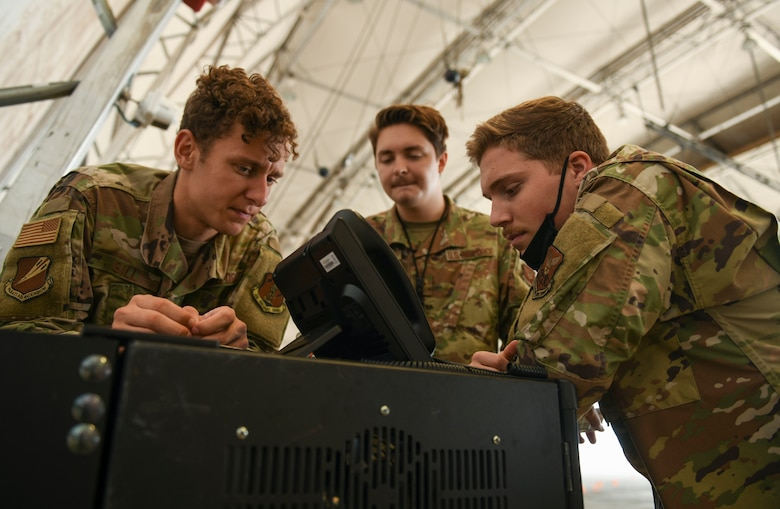 U.S. Air Force Staff Sgt. Dakota Gill, Staff Sgt. Robert Sheridan and Senior Airman Dylan Winslow, 393rd Expeditionary Bomb Squadron communications support team, Whiteman Air Force Base, Missouri, trouble shoot communication network connectivity to U.S. Air Force Global Strike Command's first mobile operations center during a deployment to Naval Support Facility Diego Garcia, August 20, 2020. Air Force Global Strike Command's development of the mobile operations center is based on the National Defense Strategy's objective to build lethality, strengthen alliances and streamline processes. Once implemented across AFGSC, the mobile operations center will allow commanders across the world to employ bomber forces to ensure a free and open Indo-Pacific and ability of AFGSC to deliver lethal, ready, long-range strike options anytime, anywhere. (U.S. Air Force photo by Tech. Sgt. Heather Salazar)