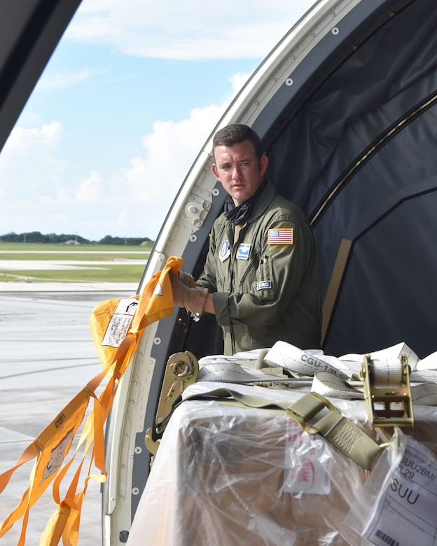 Senior Master Sgt. Aaron McLaughlin, 18th Air Refueling Squadron boom operator and load master, surveys a cargo pallet received from Andersen Air Force Base, Guam, Aug. 20, 2020, at Guam, AB. Transporting people and equipment on Air Force assets takes planning and preparation.  McLaughlin was part of a McConnell Reserve-lead aircrew that flew to Travis; Joint Base Pearl Harbor-Hickam Air Force Base, Hawaii, Andersen Air Force Base, Guam, and Royal Australian Air Force Base, Richmond, New South Wales, Australia.