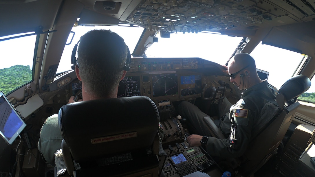 Maj. Timothy McBride (left) and Capt. Joe Schubert (right), 924th Air Refueling Squadron pilots, take off from Andersen Air Force Base, Guam, in a KC-46A Pegasus assigned to McConnell Air Force Base, Kansas, Aug. 18, 2020. The KC-46 flew to Andersen as part of the first McConnell-Reserve-lead cargo load mission. The KC-46 can carry 65,000 pounds of cargo.