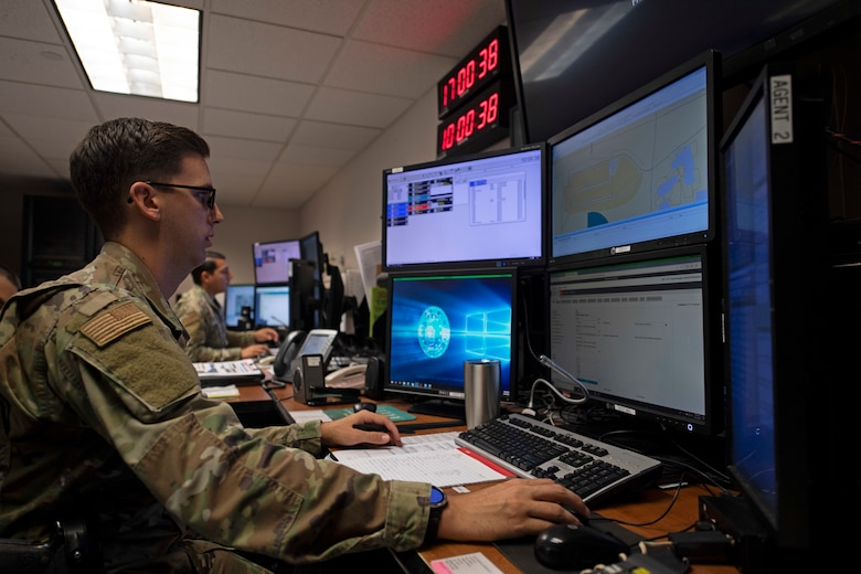 U.S. Air Force Staff Sgt. Michael Itami, 60th Security Forces Squadron emergency communications center controller, describes the process of dispatching patrols Aug. 24, 2020, at Travis Air Force Base, California. The SFS was notified Aug. 19 to evacuate more than 8,000 base personnel due to the wildfires that have burned more than 1.5 million acres in the surrounding area. (U.S. Air Force photo by Senior Airman Jonathon Carnell)