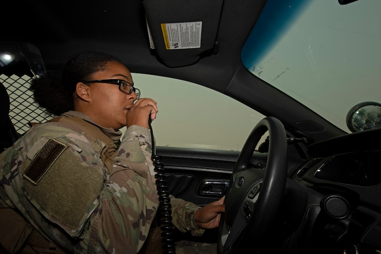 U.S. Air Force Senior Airman Dominique King, 60th Security Forces Squadron patrolman, talks on a radio Aug. 24, 2020, at Travis Air Force Base, California. The SFS was notified Aug. 19 to evacuate more than 8,000 base personnel due to the wildfires that have burned more than 1.5 million acres in the surrounding area. (U.S. Air Force photo by Senior Airman Jonathon Carnell)