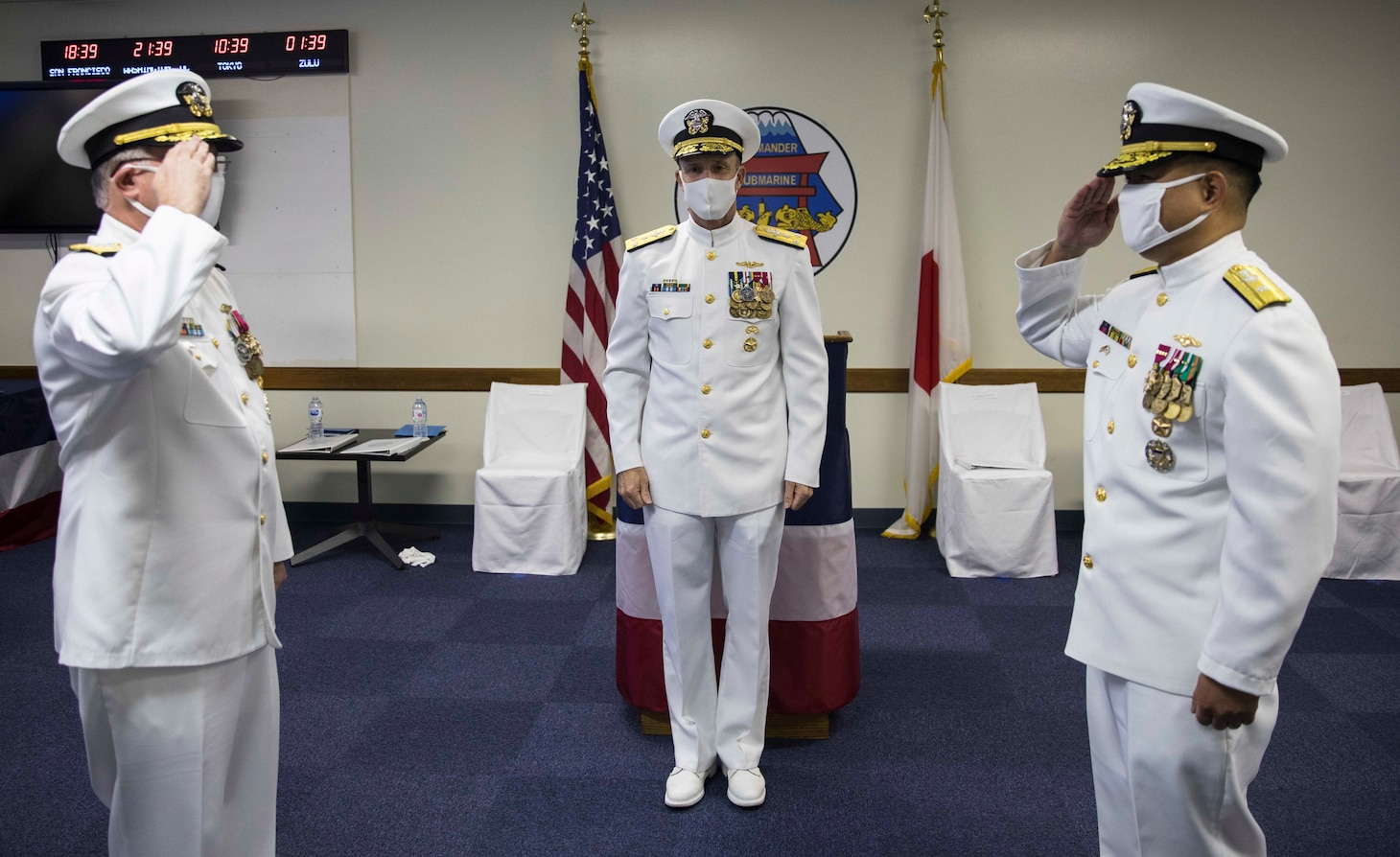 """Rear Adm. James """"Jimmy"""" Pitts, a native of Milton, Florida, relinquishes command to Rear Adm. Leonard Dollaga, a native of Vallejo, California, during Commander, Submarine Group 7's (CSG7) change of command ceremony at Fluckey Hall. Vice Adm. William Merz, Commander, U.S. 7th Fleet presided over the ceremony."""