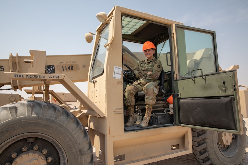Pfc. Nicole Dubois sits in the cab of a fork lift on Camp Buehring, Kuwait, on July 29, 2020.  As an automated logistic specialist with Alpha Company, 834th Aviation Support Battalion she regular operates heavy machinery to move equipment and cargo around the Udairi Landing Zone airfield. (U.S. Army photo by Sgt. Sydney Mariette)