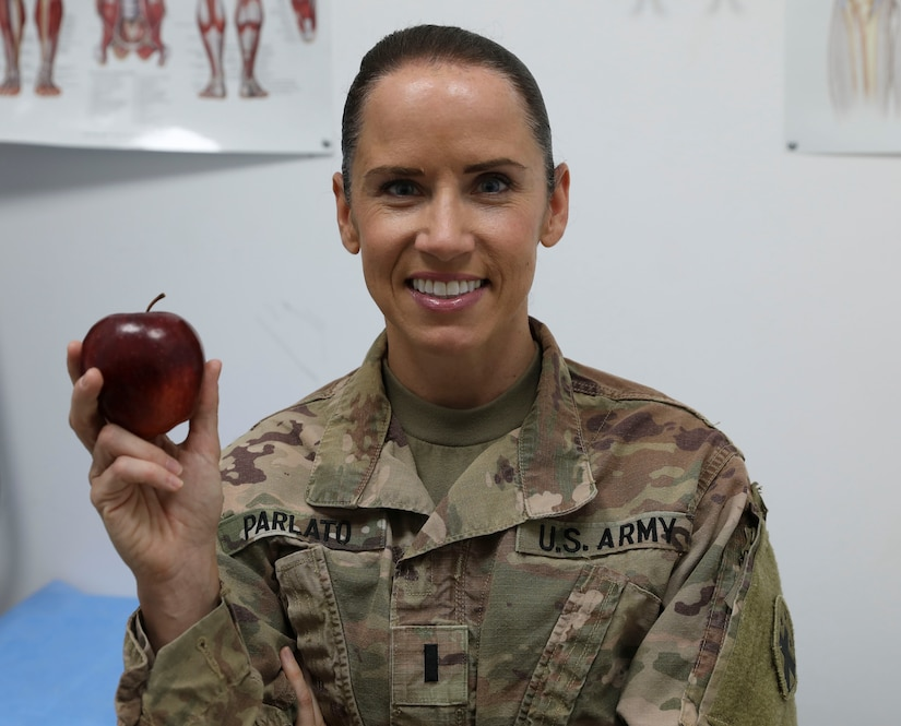 U.S. Army 1st Lt. Carolyn Parlato, assigned under the 3rd Medical Command, poses in a troop medical clinic in the Central Command Area of Responsibility on Aug. 20, 2020. Parlato serves as a Army Nutritionist or Military Occupation Specialty 65C deployed to the Middle East.