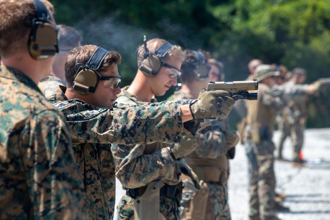 U.S. Marines with 2d Reconnaissance (Recon) Battalion, 2d Marine Division fire M45 1911 A1 pistols on Stone Bay, North Carolina, Aug. 26, 2020. 2d Recon conducted Close Quarters Tactics training to increase lethality of the unit with the M45 1911 A1 pistol at close range.