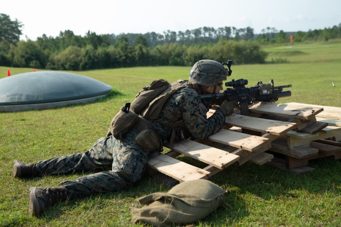 A U.S. Marine with Golf Company, 2nd Battalion, 2nd Marine Regiment, 2d Marine Division, fires at targets at unknown distances during a live-fire range on Camp Lejeune, North Carolina, Aug. 27, 2020. The Marines trained with obstacles to increase familiarity with their weapon systems and utilize it as needed in any situation.