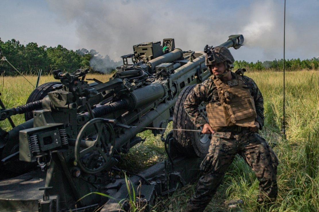 A U.S. Marine with 2nd Battalion, 10th Marine Regiment, 2nd Marine Division fires an M777A2 Howitzer during a live-fire range at Camp Lejeune, North Carolina, Aug. 27, 2020. The live-fire training promotes readiness and combat mindsets for the Marines.
