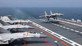 A Chinese fighter lands on an aircraft carrier
