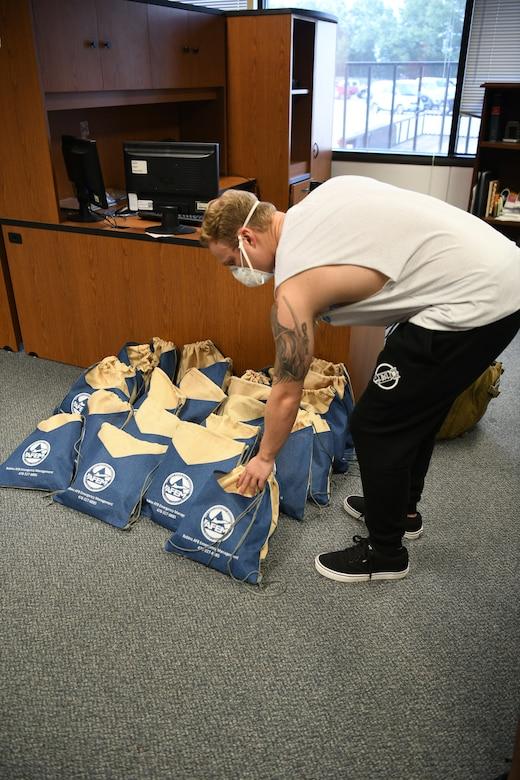 Man placing bag on pile
