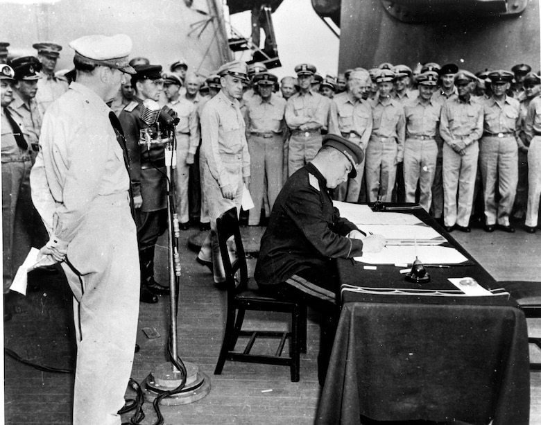Japanese General Yoshijiro Umezu signs the Japanese Instrument of Surrender onboard the USS Missouri, Sept. 2, 1945.