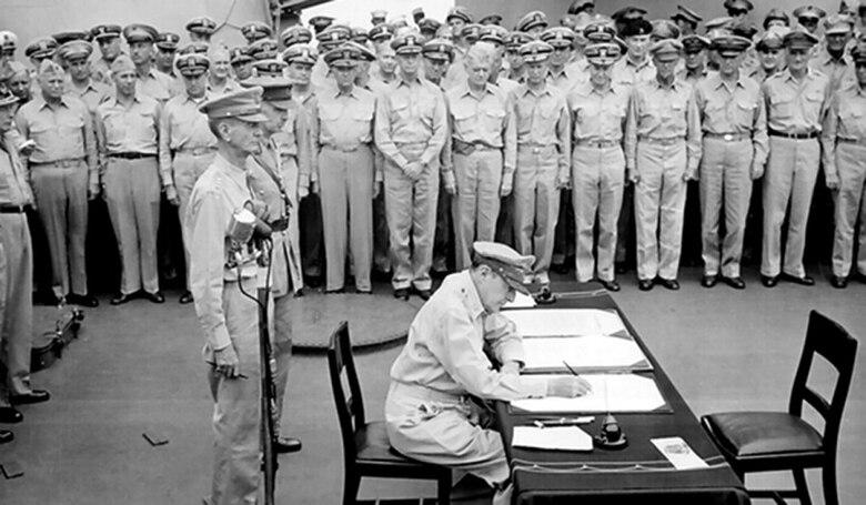 U.S. Army Gen. Douglas MacArthur signs the Japanese Instrument of Surrender onboard the USS Missouri, Sept. 2, 1945