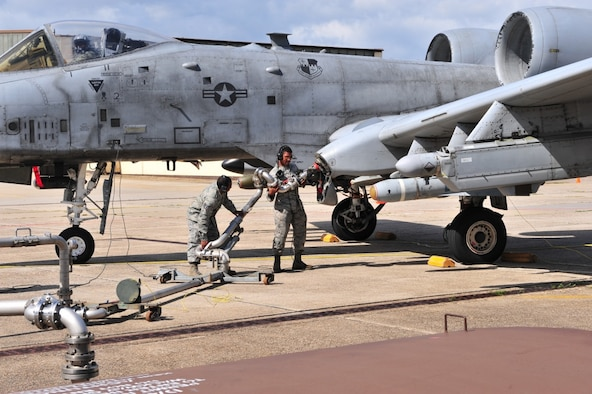 Airmen connect a jet fuel hose to an A-10 Thunderbolt II aircraft during a hot pit refueling at Spangdahlem Air Base, Germany.