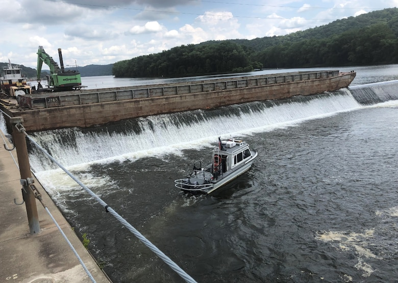 District boat scanning the riverbed downstream of the dam (U.S. Army photo by Joe Premozic)