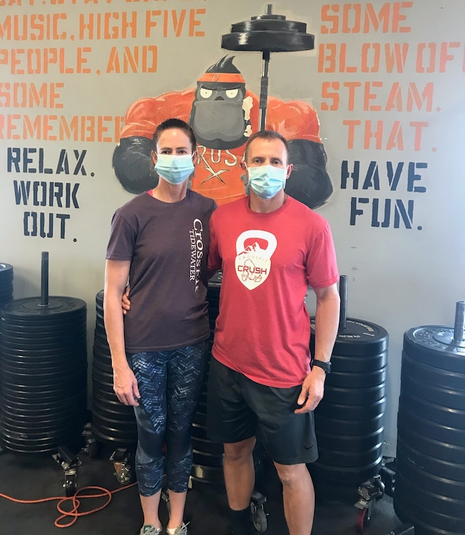 U.S. Air Force Master Sgt. Ronald Ebert, first sergeant, 140th Medical Group, 140th Wing, Colorado Air National Guard, and his wife, Alison, show that they're 'fit to fight' at the gym where they routinely exercise and lead workouts. They helped save a fellow gym member's life when he suffered a heart attack during a workout June 1, 2020.
