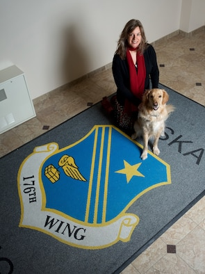 Diann Richardson, 176th Wing director of psychological health, regularly works with therapy dog, Bolt, as part of the licensed clinical social worker's outreach to the wing. Following several months of socialization and training, the golden retriever became a nationally certified therapy dog.