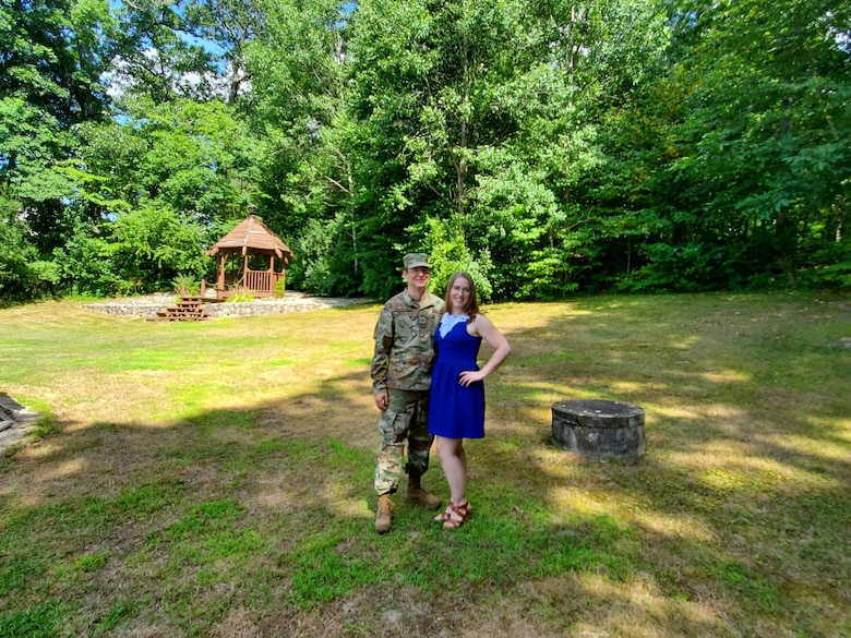 Tech. Sgt. George Seerden, 960th Cyberspace Operations Group NCO in charge of Standards and Evaluations, stands next to his significant other, Janelle, in his backyard Aug. 1, 2020, Johnston, Rhode Island. (Courtesy photo by Justine Boucher)