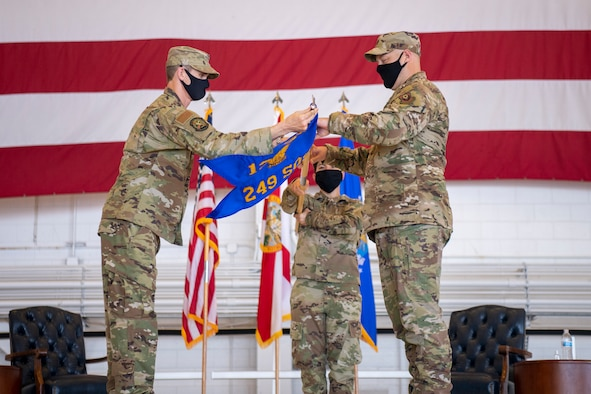 U.S. Air Force Col. Matthew French, commander of the 125th Fighter Wing, (left) salutes U.S. Air Force Lt. Col. Luke Sustman, incoming commander of the 249th Special Operations Squadron, unfurl the new squadron flag during the 249th SOS activation ceremony at Hurlburt Field, Florida, Aug. 28, 2020. The 249th SOS is assigned to the 125th Fighter Wing and is within Air Force Special Operations Command. (U.S. Air Force photo by Airman 1st Class Blake Wiles)