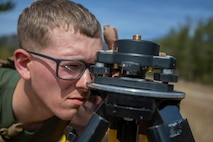 U.S. Marine Corps Lance Cpl. Justin Evans, a technical engineer specialist with Marine Wing Support Squadron (MWSS) 171 assemble the Trimble System surveying equipment during Defense Force Training 20.3 at Japan Ground Self Defense Force Camp Nihonbara, Japan, March 9, 2020. Marines with MWSS-171 are participating in a two-week field exercise to hone their skills in setting up a forward operating base, a forward arming and refueling point, and conducting mounted live fire events. (U.S. Marine Corps photo by Lance Cpl. Tyler Harmon)