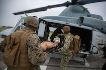 U.S. Naval Corpsman with Marine Light Attack Helicopter Squadron 369 load simulated casualties onto a UH-1Y Huey with HMLA-369 during Casualty Evacuation (CASEVAC) training on Marine Corps Air Station Futenma, Okinawa, Japan, March 12, 2020. The CASEVAC training was conducted by HMLA-369 and supported by Marine Air Group 36, Naval Hospital Okinawa in addition to the Air Force 33rd Rescue Squadron to enhance readiness and proficiency in response to emergencies while deployed in a field environment. (U.S. Marine Corps photo by Lance Cpl. Ethan M. LeBlanc)